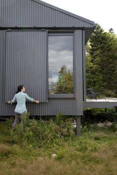 Exterior, Metal Siding Material, Cabin Building Type, Shed RoofLine, and Metal Roof Material When Alex or Bruce leave the island, closing up shop is as simple as sliding panels of corrugated metal into place to protect the windows.
