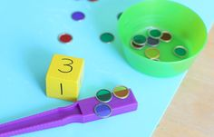 Here's a counting math game for kids perfect for practicing one to one correspondence! It's super easy to make and lots of fun for the kids!