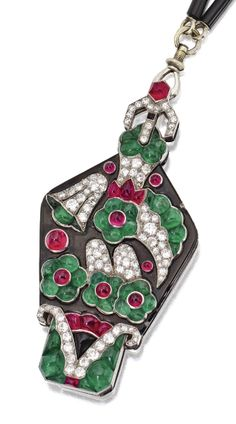An Art Deco platinum, diamond, ruby, emerald and enamel lorgnette and chain, Mauboussin, France, Circa 1922. Of floral design, set with cabochon rubies and emeralds, a square cabochon onyx, and old European-cut, round and single-cut diamonds, enclosing a pair of hinged lenses, supported by a onyx and platinum link chain, numbered, maker's mark, French assay marks.