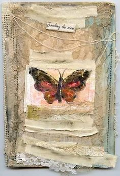 This beautiful butterfly is from a handmade mixed media journal by the very talented DJ Pettit