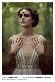 deep v neckline.  pulled back hair accented with a headpiece