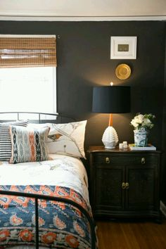 Dark blue and wood spare bedroom