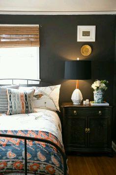 Dark blue and wood spare bedroom