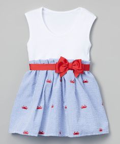 Dress your little darling in cool comfort with this oh-so-sweet dress boasting a bright red bow and a playful crab print.