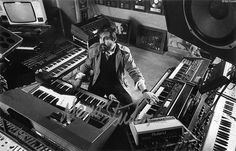 Vangelis composing on his synthesisers while looking at a film scene displayed on a video screen, which was located behind the mixing desk in front of him. The television screen on top of the grand piano behind Vangelis assisted the studio engineer at the mixing desk, who had to synchronise the start of the tape recorder with the start of a pre-selected video frame from the film scene.  - Scoring the music, Nemo Studios.