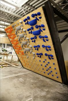 Now that's an awesome System Wall!   http://www.atomikclimbingholds.com/system-hang-board-climbing-holds