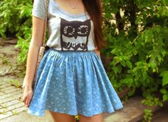 Hoot! An adorable owl v-neck matched with a high-waisted skirt.