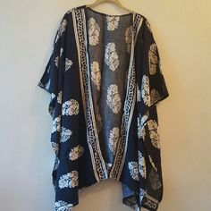 NWT Blue and Cream feather Design Chic Kimono Beautiful deep blue kimono with lovely organic print throughout and along bottom hem and down front. Very soft knit blend. Beautiful statement piece! Oversized small, medium could wear with no issues Jackets & Coats Capes