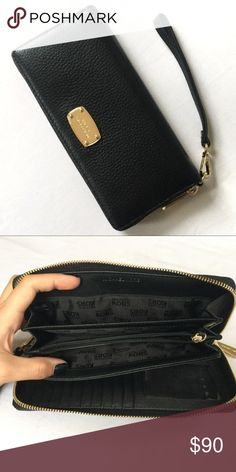 Michael Kors Jet Set Wristlet / Wallet Michael Kors Jet Set wallet in black with gold accents. Tons of storage  10 card slots on one side 6 car slots and 3 large slots and change pocket on the other side  Gently worn Open to trades Michael Kors Bags Wallets