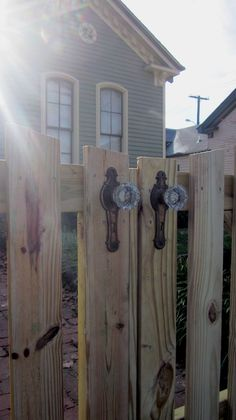 A fence with beautiful door handle knobs | Stratton Exteriors