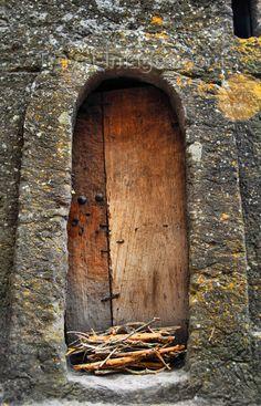 Lalibela, Amhara region, Ethiopia: door in the rock wall around Bet Medhane Alem church
