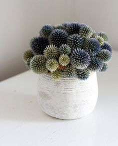 Modern floral arrangement& Mound by Flores del Sol on Etsy. Love the wide range of muted colors& greys, blues, greens and yellows.