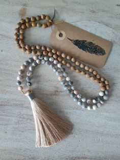 This gorgeous, partially hand knotted mala is made with 6 mm pink zebra jasper, 6 mm wood jasper, gold glass seed beads and an earthy tan silk tassel. Gold Glass, Pink Zebra, Jasper, Seed Beads, Tassel Necklace, My Etsy Shop, Check, Jewelry, Jewels