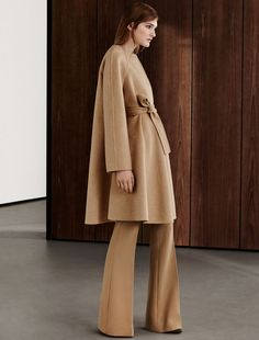 MAXMARA | Double layered pure cashmere coat with raglan sleeves and a flared line on the bottom. The hand made detail, which combines two layers of fabric, means that the garment has no need of a lining. Pockets on the sides. Matching belt | Product name: PRISMA | Product code:1086075506002 | Colour: Beige-cammello | €2,300