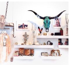 like this idea for my art room... wanna put up some white shelves