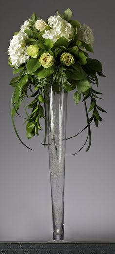 White and green tall wedding centerpiece