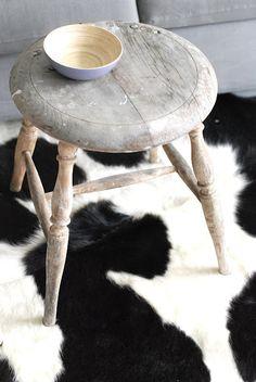 We love the faux Holstein print rug.