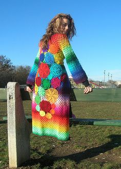 This one of a kind extralong sweater coat is made of 21 different shades of the rainbow: burgundy, red, orange, sun yellow, light yellow, neon green, mint green, emerald green, dark pine green, teal, turquoise, blue, dark blue, purple, dark violet, violet, lilac, baby pink, salmon, neon pink, magenta.  Yes, I used all the colours I was able to find! XD  I decorated the back with many different doilies for the craziest boho look I've ever created!!!  Closed with replaceable burgundy knitted…