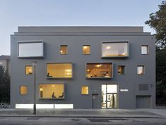 Extraordinary Facade with 5 Skewed Bay Windows on All-grey Apartment Block in Berlin