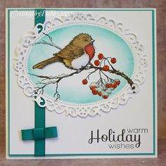 handmade winter/holiday card from A Scrapjourney ... delightful robin on a berry branch ... luv the fluffed up winter look of the bird and fluffy snow on the branches and lover berries ... great card!