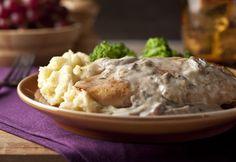 Brown the chicken in a skillet for bonus flavor before baking it smothered in a scrumptious cream sauce.