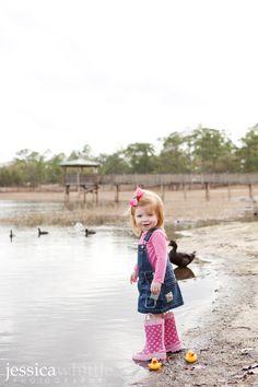 Splashing in the lake with three-sizes-too-big rain boots.