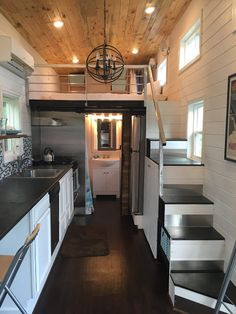 Luxurious tiny house, view of stairs, loft, kitchen and bath.