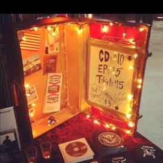 The merch display I created with a friend by revamping a vintage suitcase