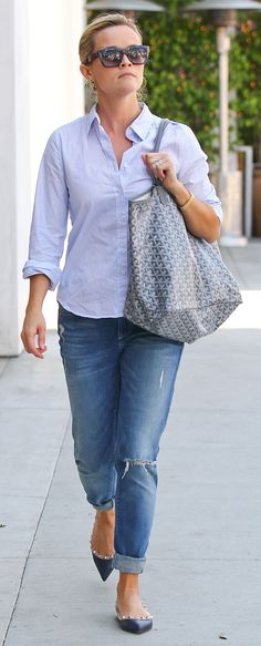 Reese Witherspoon in boyfriend jeans and Valentino rockstud flats