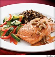 This salmon #recipe features a zesty, low calorie sauce of lime juice, chili powder and pepitas for a delicious taste of Mexico.
