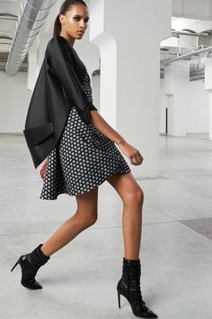 Luxe, Masculine Dressing With Feminine Twist In Antonio Berardi Pre Fall 2015 - Modern tuxedo black blazer is worn atop dotted flared dress. I love these black leather pointed-toe ankle boots.