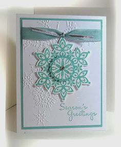 Stamps: Festive Flurry Merry More Messages Paper: Pool Party, Whisper White Ink: Pool Party Accessories: seam binding ribbon, silver ribbon, rhinestone, dazzling details Tools: Big Shot, Northern flurry EF, scallop circle punch, circle punch