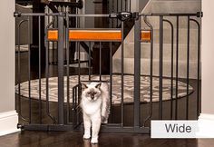 """Walk-Thru Pet Gate with Small Pet Door @ Sharper Image - No more climbing over gates or removing them altogether to let yourself or your small pets through. The Walk-Thru Pet Gate with Small Pet Door features a clever 10"""" x 7"""" portal that lets cats and small dogs pass through, while large pets and small children stay put. Great idea! Sells for $70. [Pet Door, Pet Gate, Animals] #NerdMentor"""