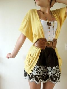 Really cute outfit!  Shortsleeve open yellow cardi with wide belt, white tank and short black white-scalloped skirt