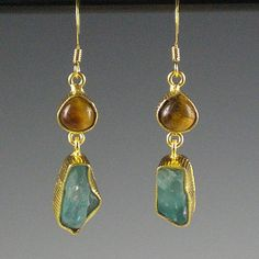 These earrings feature rough, raw green apatite nuggets dangling from smooth tiger eye cabochons. Earrings are set in hammered 22-karat gold-plated brass bezels. UK seller. £13.99
