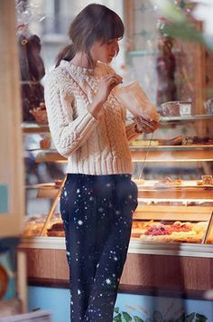 Cozy sweater paired with galaxy trousers