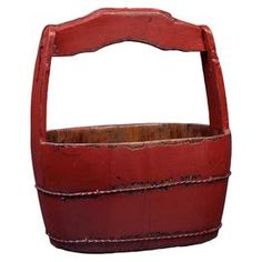 Weathered wood bucket in red.  Product: BucketConstruction Material: WoodColor: RedFeatures:  Brings on-trend style to your home with this chic designSlightly faded coloring Dimensions: 20 H x 18 W x 12 D