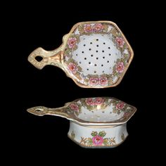 Vintage Porcelain Floral and Heavy Gold Trim Tea Strainer and Receptacle. $225.00, via Etsy.