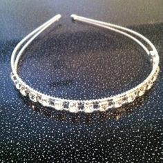 Gorgeous Austrian Crystal Headband by HOLLYWOODHAIRSECRET. $5.99. This headband is a perfect accessory for any occasion. This sophisticated design has everything you look for in a headpiece. It is incredibly light to wear, very versatile and will sparkle seductively in your hair.. Items Description:   Condition: Brand New 100%   Size: 40cm   Very popular and useful hair accessory.   Noted: This is hand made .  Thanks!!!    Package includes:  1x hair band