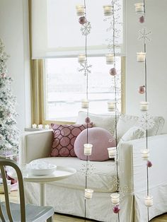 Hanging Candles  (not where traffic of my friends!! LOL)  Create a falling-snow look with wire lines suspending votive holders, shimmering snowflakes, and pretty ornaments. Use battery-powered votives so you can leave the display lit even when you can't be around to monitor it.