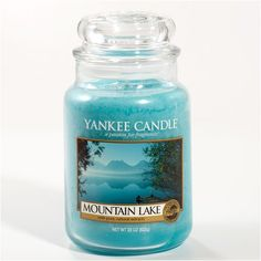 Yankee Candle Mountain Lake ... A refreshing retreat ... the cooling scent of mountain pines and cypress with notes of lily and musk.