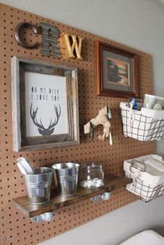 I love the pegboard, shelf, and baskets but may need to make it narrower so E doesn't grab things