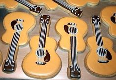 Guitar Decorated Cookies make a great gift for the person who loves music made on string instruments. Fancy Cookies, Cut Out Cookies, Iced Cookies, Cute Cookies, Royal Icing Cookies, Cupcake Cookies, Sugar Cookies, Sweet Cookies, Cookie Favors