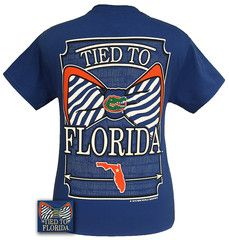 """Details:This classic fit pre-shrunk jersey knit tee is 6-ounce 100% cotton. """"Tied to Florida"""" is the perfect tee to show your pride!Available in sizes- S,M,L,XL,2X"""