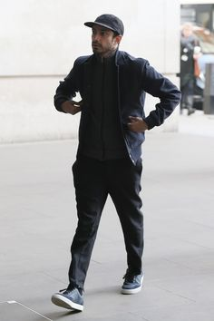 Actor Riz Ahmed looks stylish in spring layers - including a jacket over a zip-up sweater - while out in London.