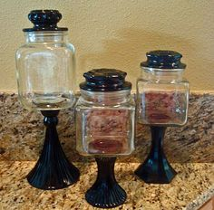 Glass candlesticks and jars