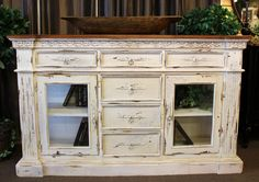 Large Habersham style sideboard buffet painted a distressed white.  Sideboard has 6 drawers, 2 beveled glass doors. #OnTheShowroomFloor #Large #Habersham #Style #Sideboard #Buffet #Painted #Distressed #White #Dining #Kitchen #Entry #Foyer #Study #Office #Library #Hall #Living #Bedroom #StillGoode