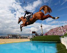 Henrik Von Eckermann of Sweden rides his horse Allerdings in Individual Jumping qualifiers.