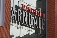 A sign is pictured outside a cordoned off Arndale Centre shopping complex in Manchester, northwest England on October 11, 2019, following a series of stabbings. - (Photo by Lindsey Parnaby / AFP) (Photo by LINDSEY PARNABY/AFP via Getty Images)