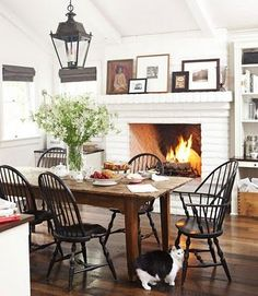 Dining/fireplace - could paint stone and room white to show off dark wood furniture?